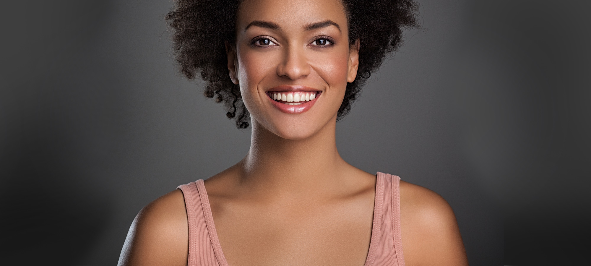 Young woman smiling with perfect teeth